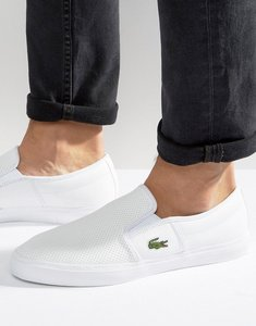 Read more about Lacoste gazon leather slip on plimsolls - white