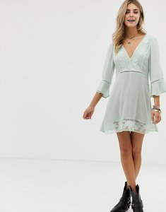 Read more about En creme skater dress with floral lace inserts
