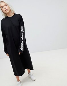 Read more about Weekday open back dress with slogan sleeve - black