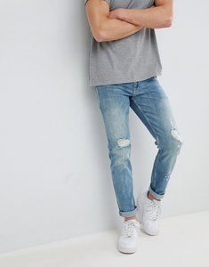 Read more about Asos design slim jeans in mid wash blue with rips - mid wash blue