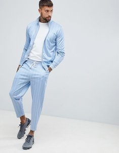 Read more about Asos design tracksuit track jacket tapered cropped joggers with pin stripe in blue - blue