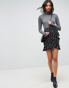 Read more about Asos design mini wrap skirt in polka dot print - mono