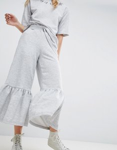 Read more about Asos made in kenya awkward length sweat trousers with frill hem - grey
