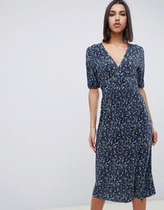 Read more about Asos design midi ditsy print plisse tea dress with elasticated waist