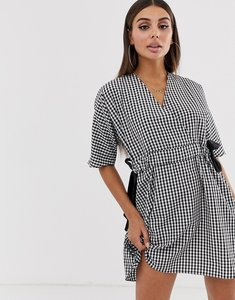 Read more about Asos design v front v back ruched waist mini smock dress in gingham