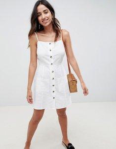 Read more about Asos design button through linen mini sundress - white