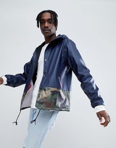Read more about Herschel supply co forecast hooded coach jacket rubberised in navy camo - peacoat camo