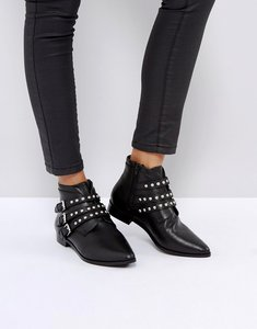 Read more about Asos alerted leather studded ankle boots - black