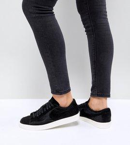 Read more about Nike blazer low premium trainers in black ponyskin - black