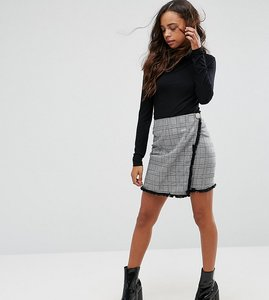 Read more about Missguided petite checked frayed edge wrap mini skirt - black check
