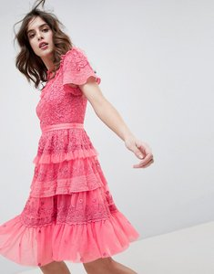 Read more about Needle thread high neck layered mini dress with ruffle sleeves in hot pink - hot pink