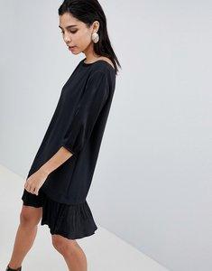 Read more about Sisley pleat drop waist hem dress - black