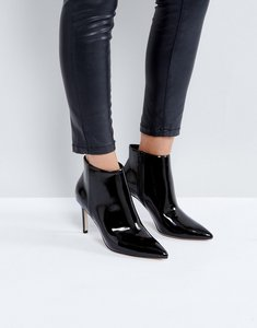 Read more about Asos emberly point ankle boots - black patent