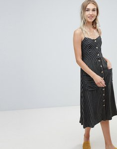 Read more about Warehouse midi cami dress with button front detail in black stripe - multi