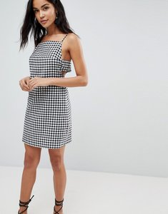 Read more about Asos high neck tab side mini sundress in gingham - multi