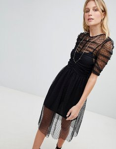 Read more about Asos ruched midi dress in spot mesh - black