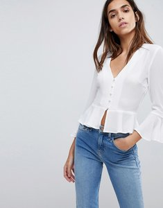 Read more about Missguided button detail peplum blouse - white