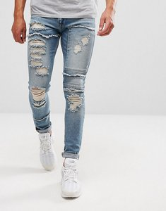 Read more about Asos super skinny jeans in vintage mid wash with heavy rips and repair - mid wash blue