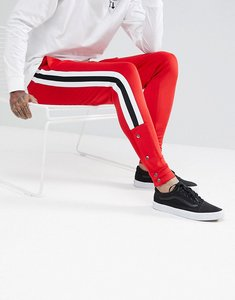 Read more about Asos skinny joggers in red poly tricot with side stripe and popper hem - rooney red