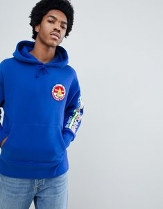 Read more about Tommy jeans 90s sailing capsule back and sleeve logo hoodie in bright blue - surf the web