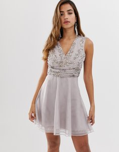 Read more about Asos design mini dress with pearl and sequin embellished wrap bodice
