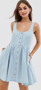 Read more about Asos design denim scoop neck button front skater mini dress in lightwash blue