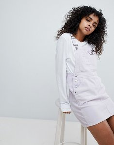 Read more about Asos design cord dungaree dress in lilac - lilac