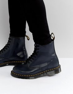 Read more about Dr martens 1460 8 eye graphic embossed boots - navy