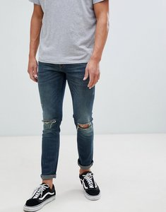 Read more about River island skinny fit jeans with knee rips in mid wash blue