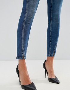 Read more about Asos lisbon skinny mid rise jeans in mid wash blue with twisted seams - mid wash
