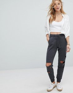 Read more about Hollister tracksuit pant with distressed knees - grey