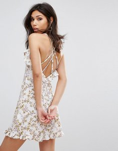 Read more about Prettylittlething printed frill strappy swing dress - white