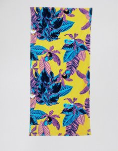 Read more about Monki tropical print beach towel in yellow tropical - yellow tropical