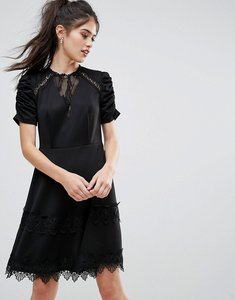 Read more about Club l detailed crochet lace skater dress with puff detailed sleeves - black