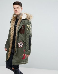 Read more about Pretty green x the beatles lonely hearts club parka jacket in green - khaki