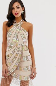 Read more about Asos design mini dress with wrap neck and aztec embellishment fringe