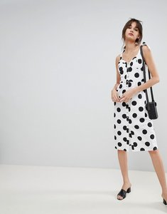 Read more about Neon rose midi sun dress with button front in spot - white