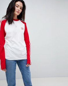 Read more about Adidas originals adicolor three stripe raglan top in red - red