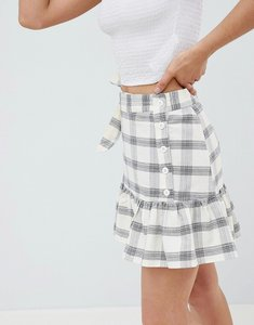 Read more about Asos design mini skirt with side buttons in check - multi