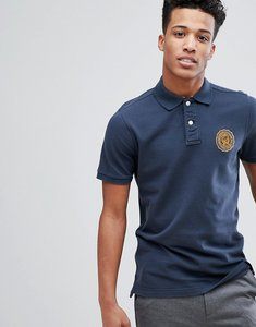 Read more about Abercrombie fitch heritage varsity badge logo slim fit polo in navy - navy