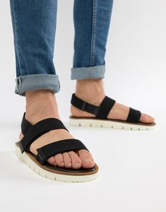 Read more about Asos design sandals in black tape with white sole - black
