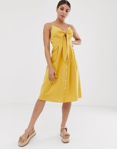Read more about Missguided tie front midi dress with button detail in yellow
