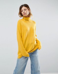 Read more about Asos jumper in fluffy yarn and roll neck - mustard