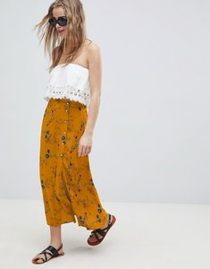 Read more about Asos design midi skirt with side buttons in spring floral print - multi