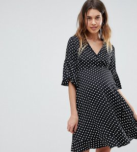 Read more about Queen bee ruffle tea dress in polka - multi