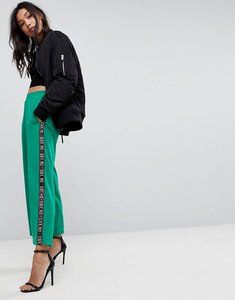 Read more about Asos premium scuba wide leg joggers with printed side tape - green