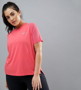 Read more about Nike plus running dry miler tee in pink - sea coral reflectiv