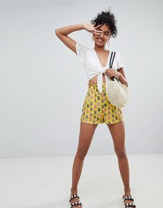 Read more about Monki tiger print shorts in yellow - yellow