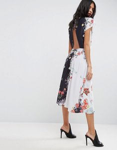 Read more about Asos midi dress with high neck and open back in placement swan print - multi