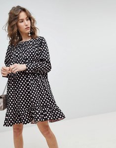Read more about Sister jane long sleeve smock dress with peplum hem in oversized polka dot - black pink spot